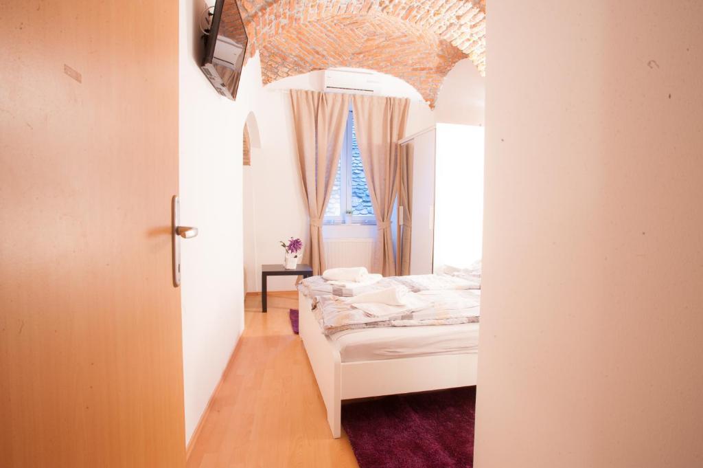 Un ou plusieurs lits dans un hébergement de l'établissement Guest House Nokturno