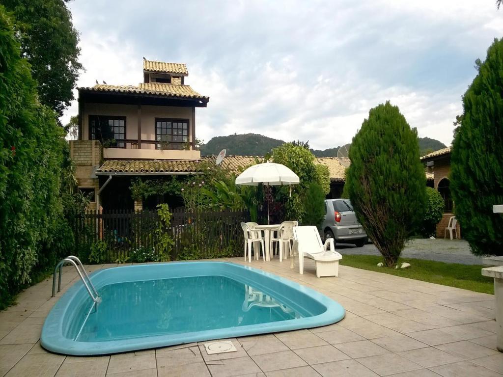 The swimming pool at or near Pousada Marujo