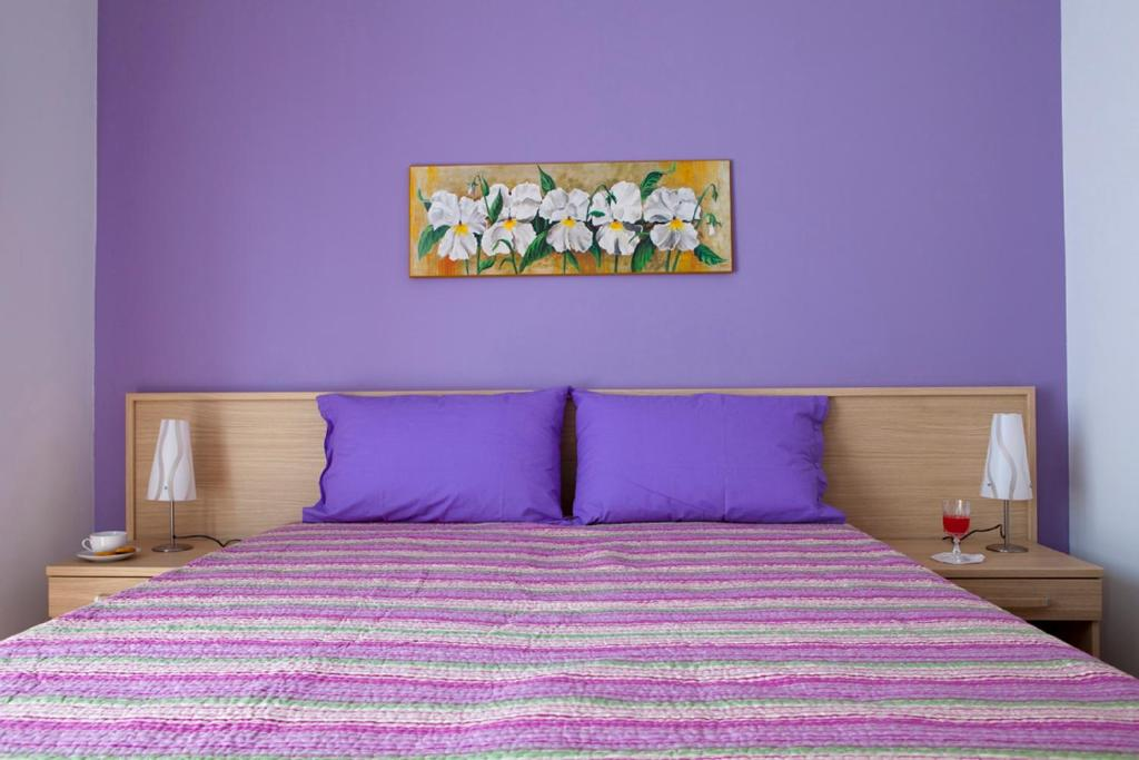 A bed or beds in a room at B&B Vado Al Massimo