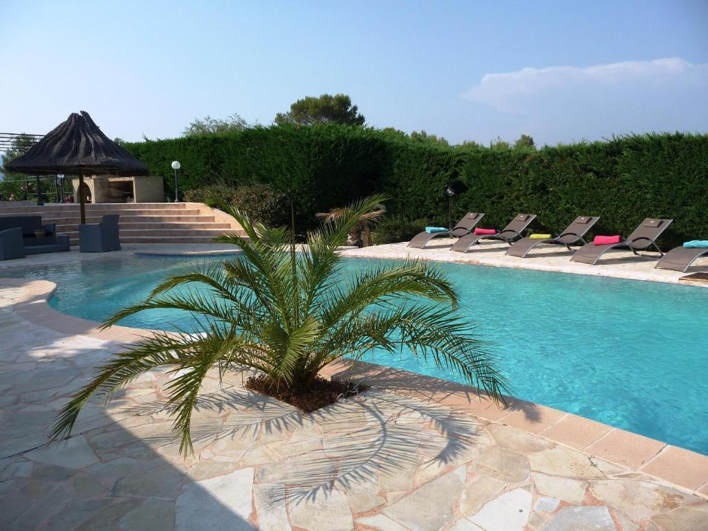 The swimming pool at or close to La Bastide Des Selves