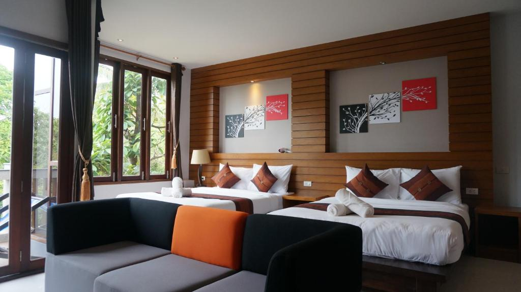 A bed or beds in a room at Lanta Intanin Resort