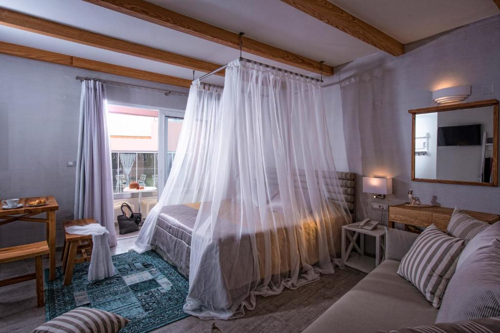 A bed or beds in a room at Omiros Boutique Hotel (Adults Only)