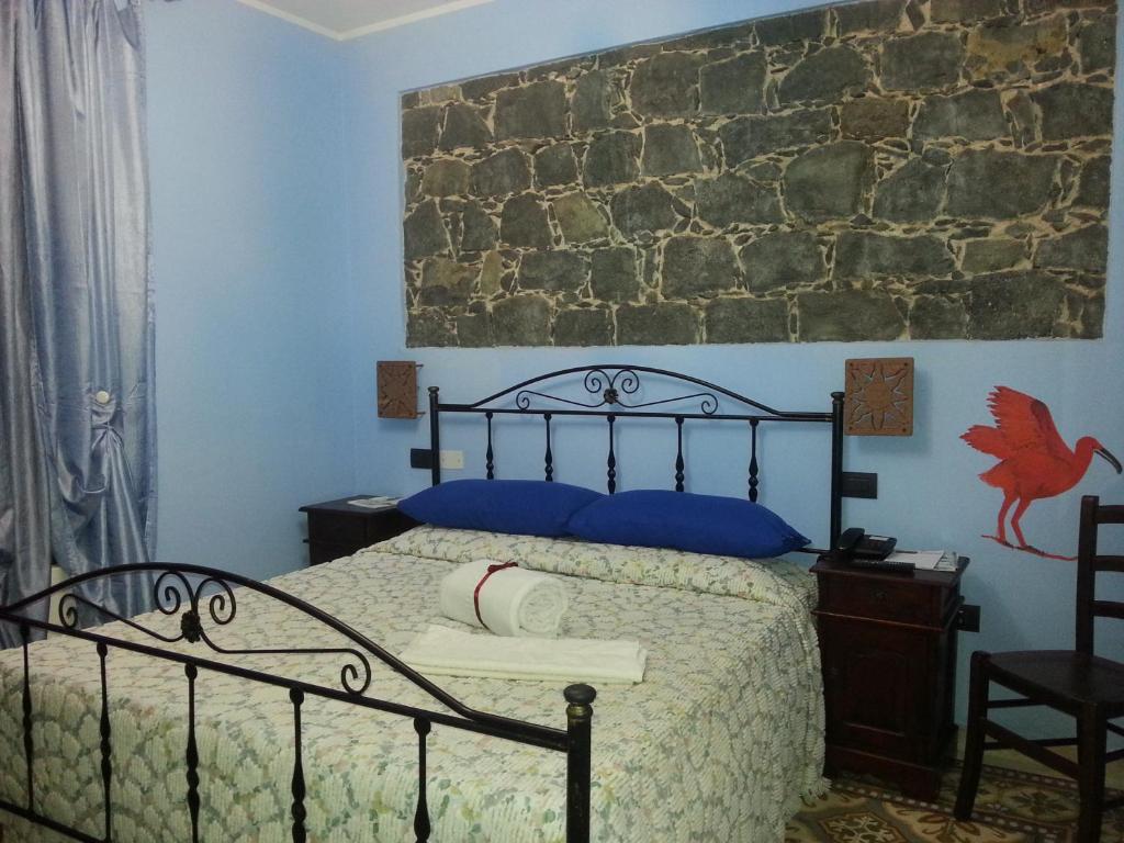 Cama o camas de una habitación en La Corte di Lucina