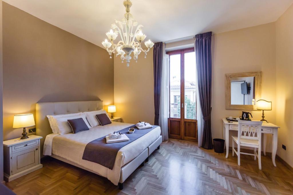 A bed or beds in a room at I Cipressi del Poggio B&B