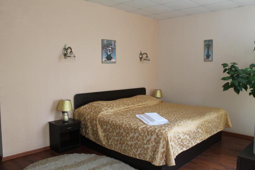 Кровать или кровати в номере Мини-гостиница Сказка