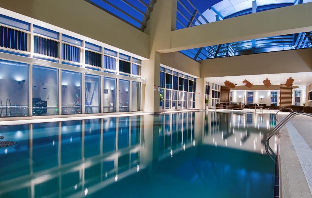 Condo hotel grand millennium wahda abu dhabi uae - Hotels in abu dhabi with swimming pool ...