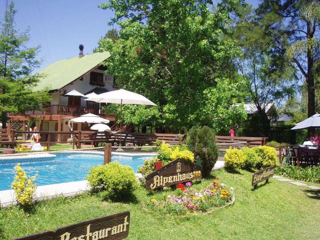 The swimming pool at or near Alpenhaus Hostería Restaurant