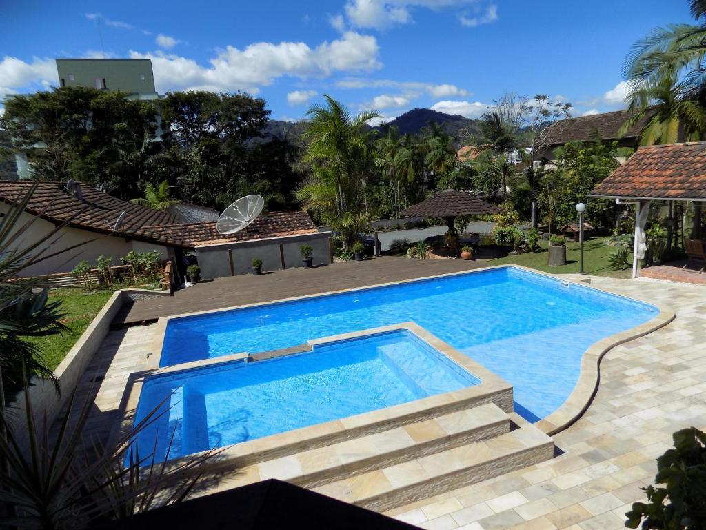 Vista de la piscina de Pousada Lena Rosa o alrededores
