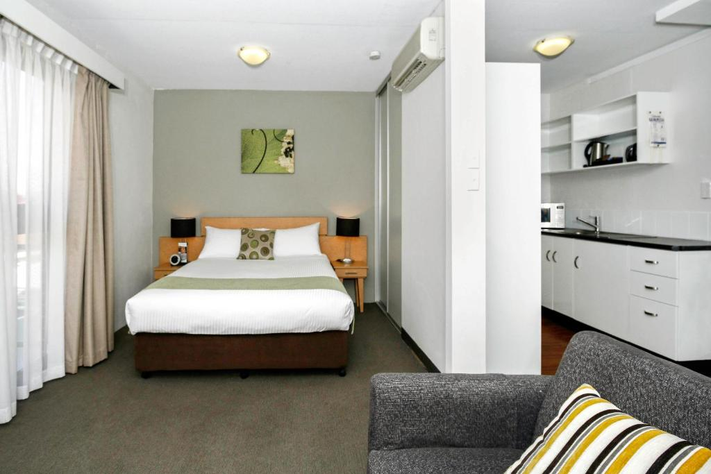 A bed or beds in a room at BreakFree Adelaide