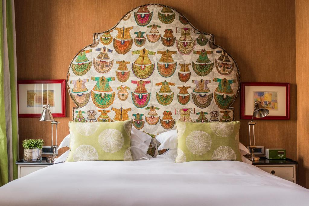 A bed or beds in a room at Vmaison Luxury Hotel