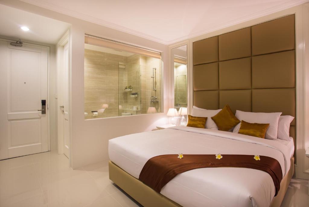 Un ou plusieurs lits dans un hébergement de l'établissement Amalfi Hotel Seminyak