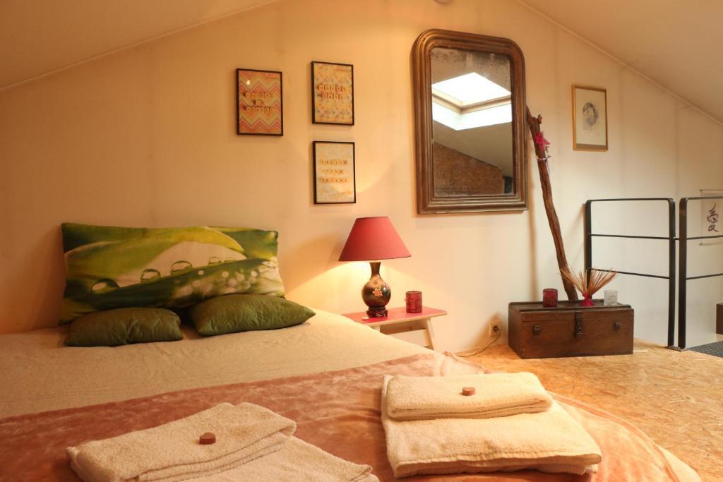 Un ou plusieurs lits dans un hébergement de l'établissement Absolut Zen