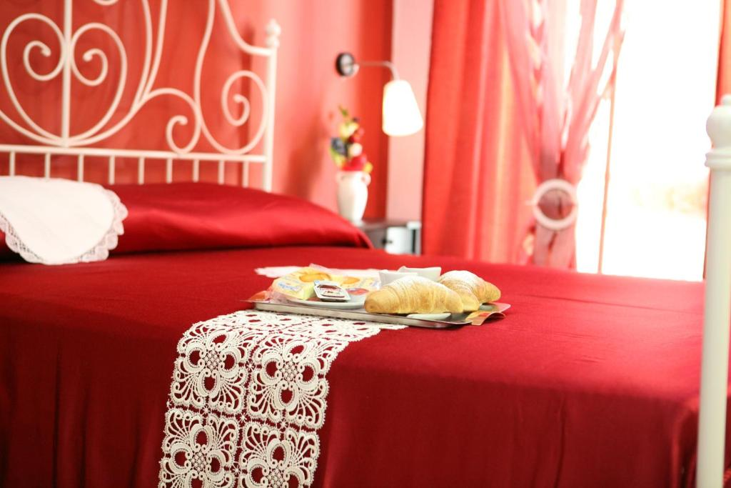 A bed or beds in a room at B&B Dolcevita