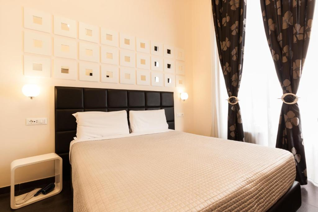 A bed or beds in a room at Deko Rome