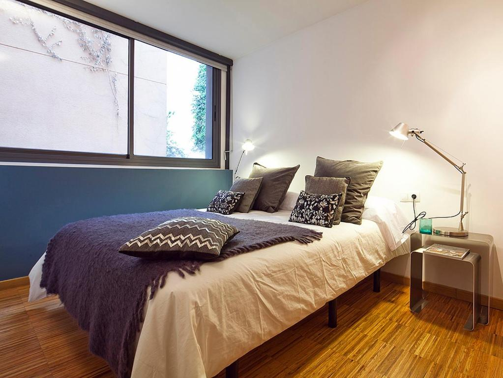 A bed or beds in a room at My Space Barcelona Park Güell Apartments