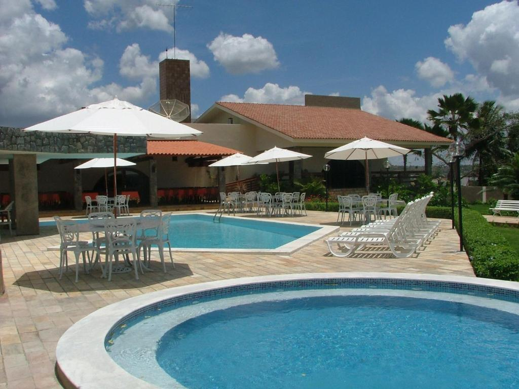 The swimming pool at or near Hotel Três Palmeiras