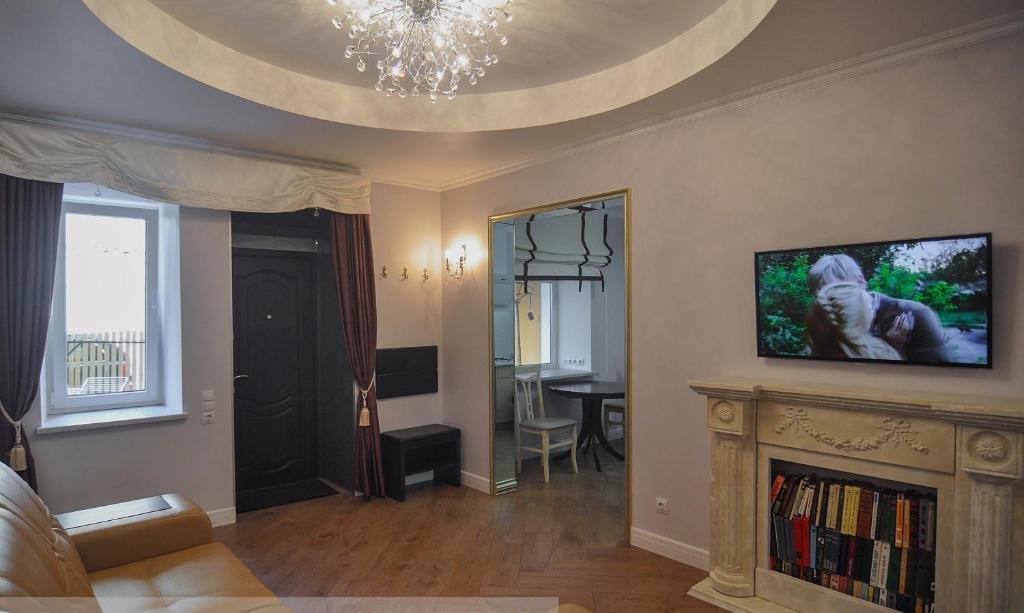 Телевизор и/или развлекательный центр в Apartment u Kamina