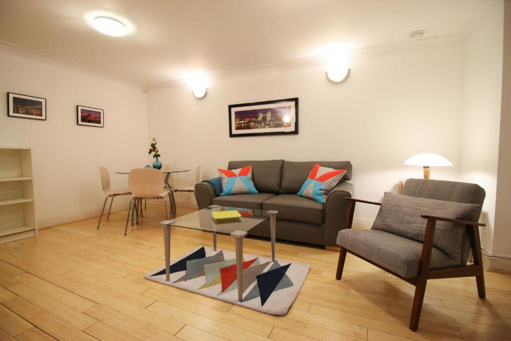 A seating area at Prestige Apartments Octave House