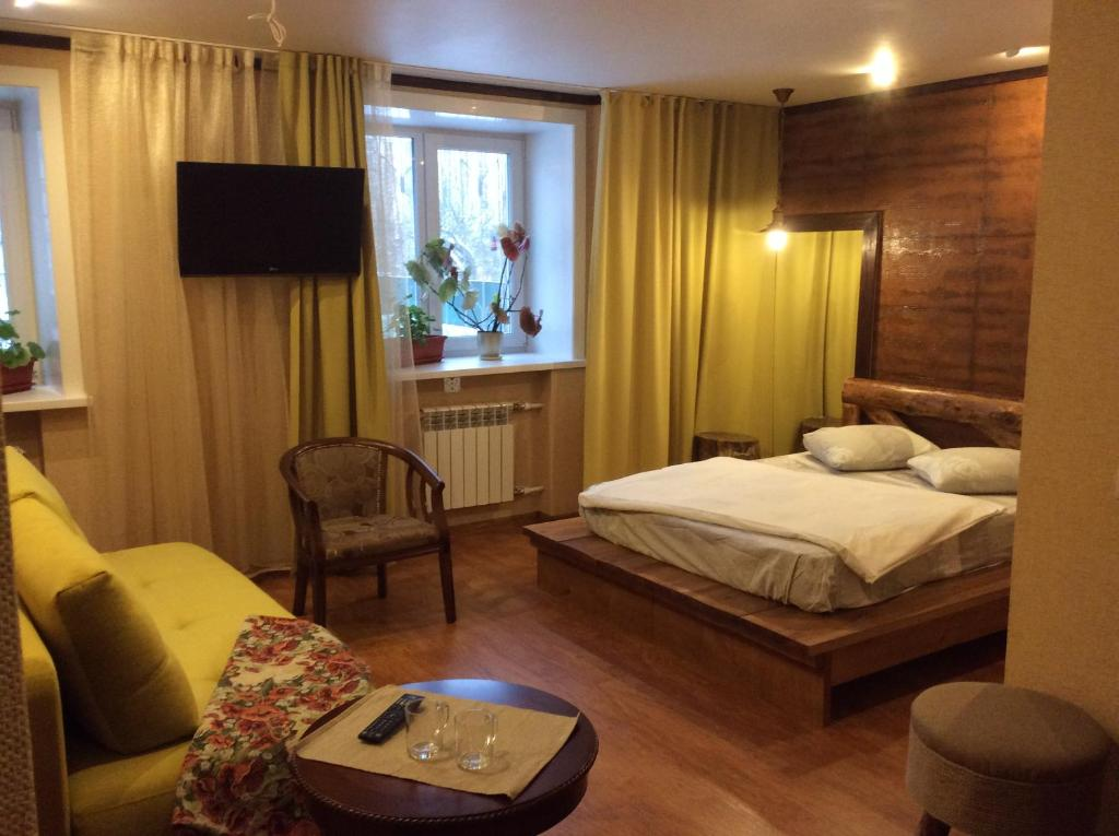 A bed or beds in a room at Hotel Shumak