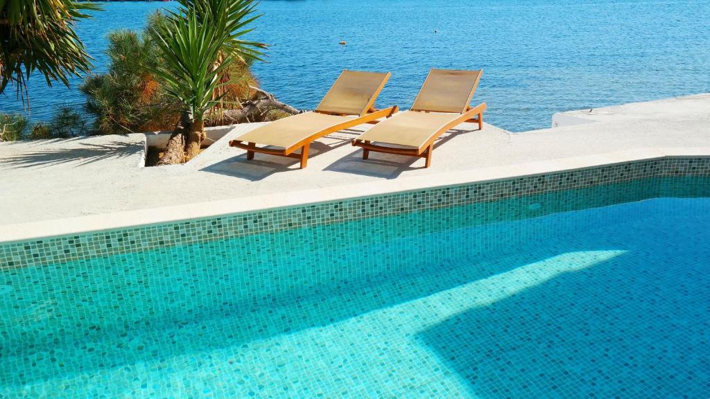 The swimming pool at or near Porto Evia Boutique Hotel
