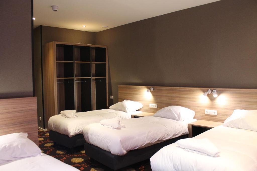 A bed or beds in a room at Aston City Hotel