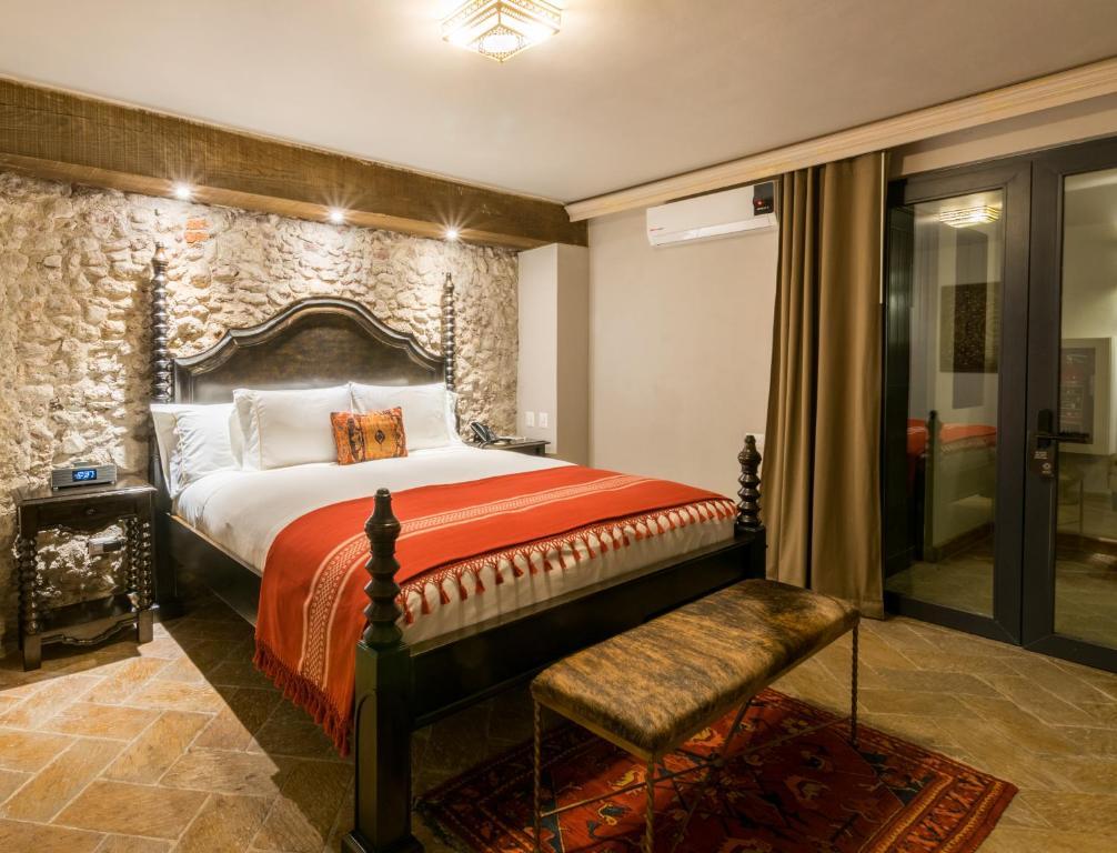 Un ou plusieurs lits dans un hébergement de l'établissement Casa 1810 Hotel Boutique