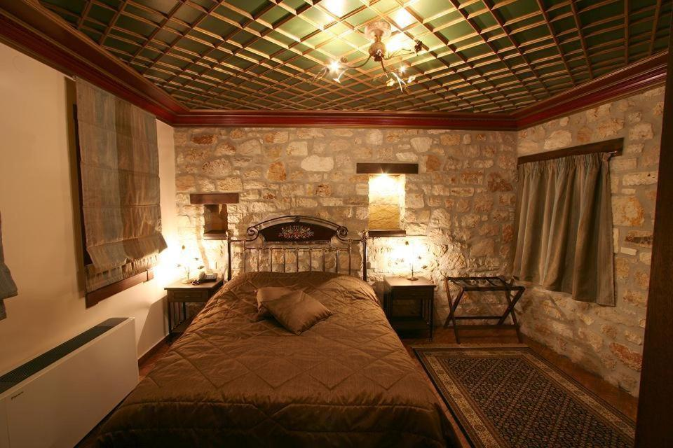 A bed or beds in a room at Hagiati Guesthouse