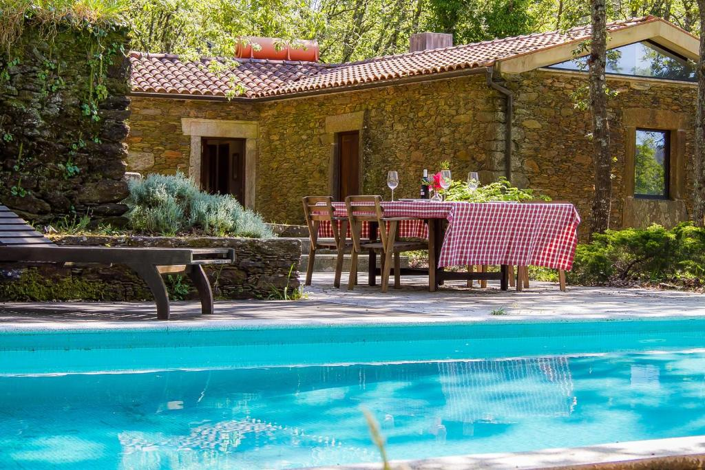 The swimming pool at or near Liiiving in Caminha | Oak Tree Chill House