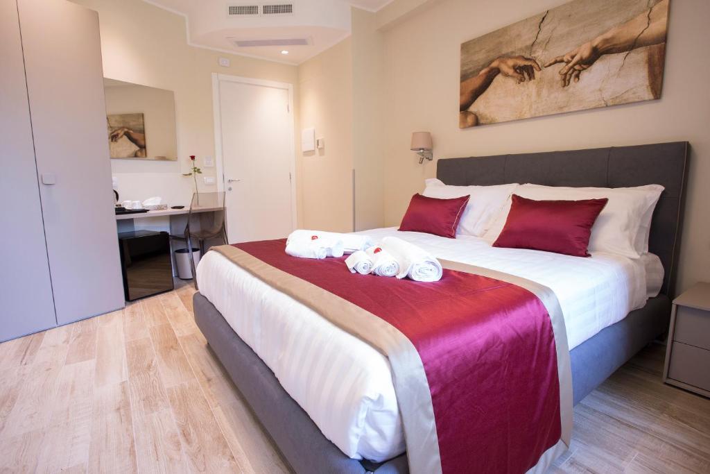 Un ou plusieurs lits dans un hébergement de l'établissement Leonardo Da Vinci Guest House
