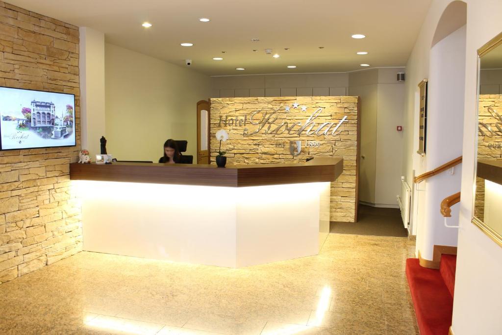Lobbyn eller receptionsområdet på Hotel Rochat