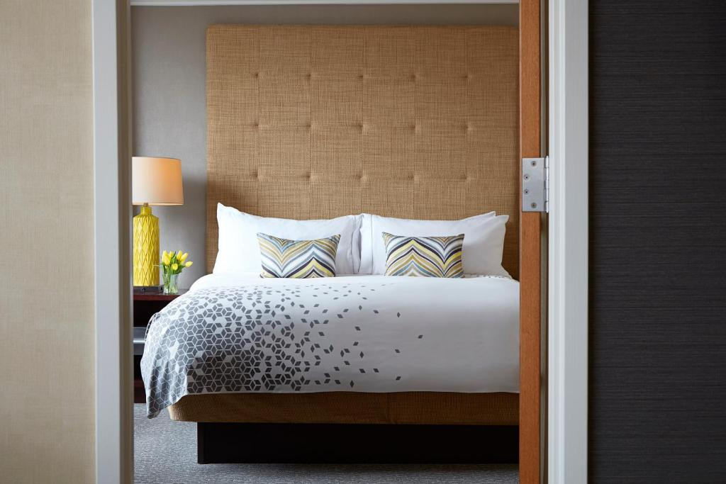 A bed or beds in a room at Renaissance Columbus Downtown Hotel