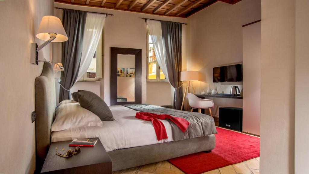 A bed or beds in a room at Palazzo Medusa