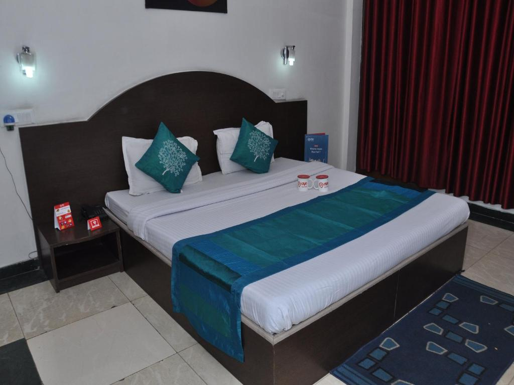 A bed or beds in a room at OYO 3266 Neo Vedic Resort
