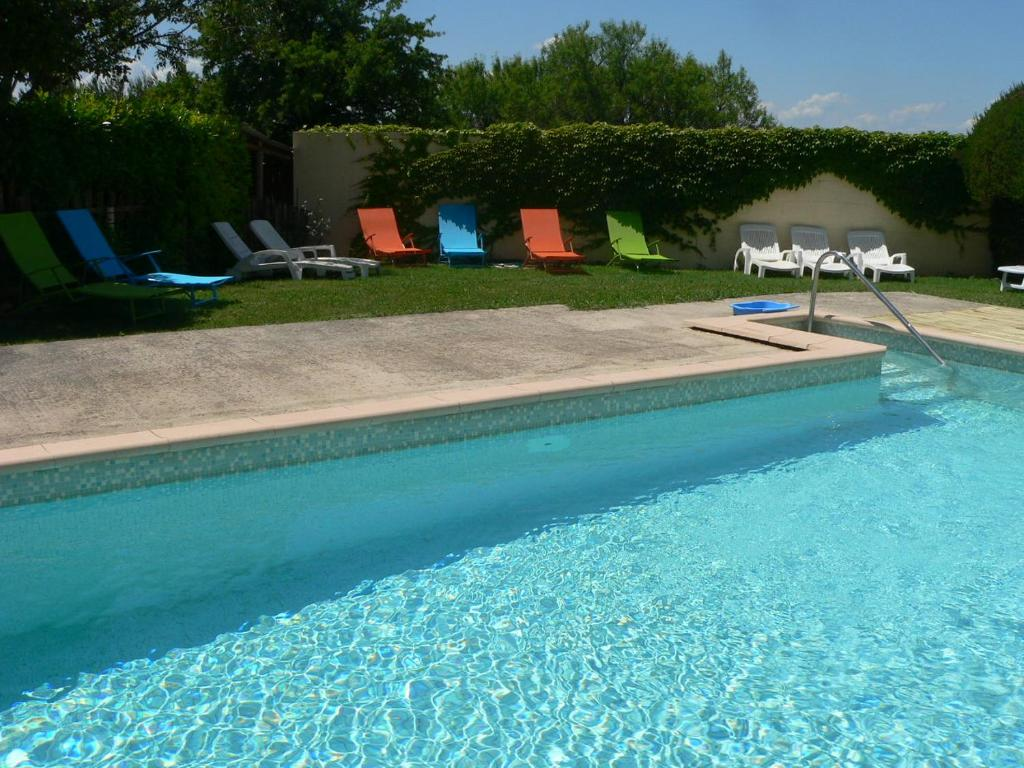 The swimming pool at or near Chambres d'Hôtes Chez Cécile