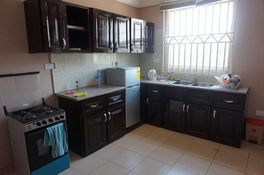 Charming furnished apartment ghana burma camp for Kitchen cabinets ghana