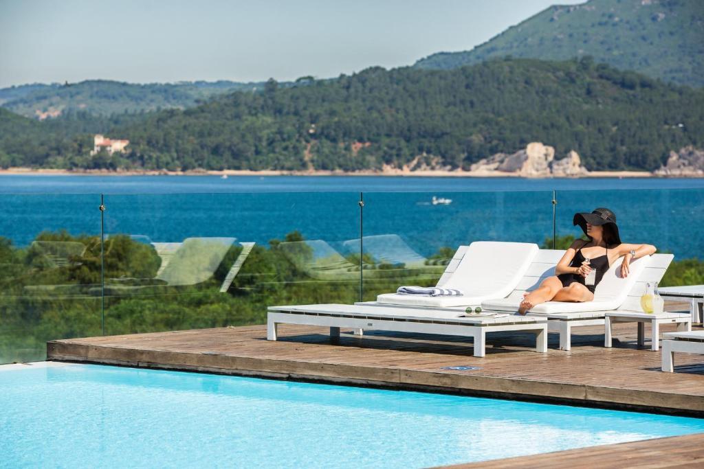 Hotel outdoor pool design  Troia Design Hotel, Portugal - Booking.com
