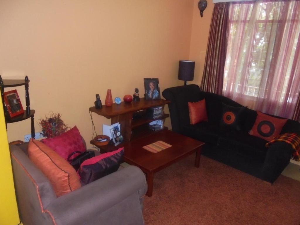hotel property of com one nairobi this kenya gallery bedroom image furnished cozy booking ke apartment