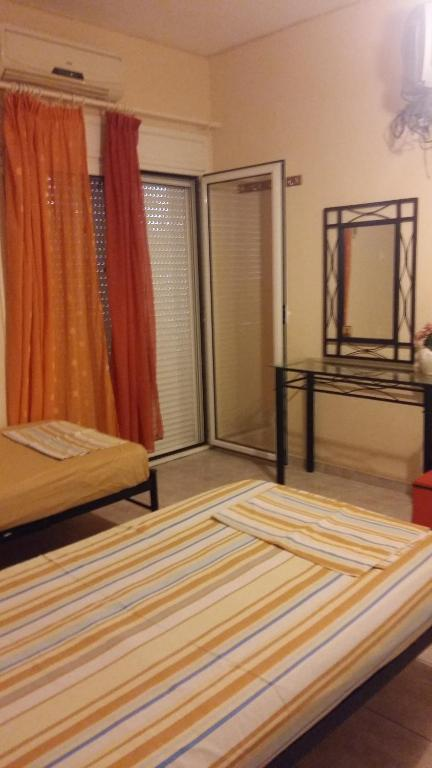 A bunk bed or bunk beds in a room at Aliveri Rooms