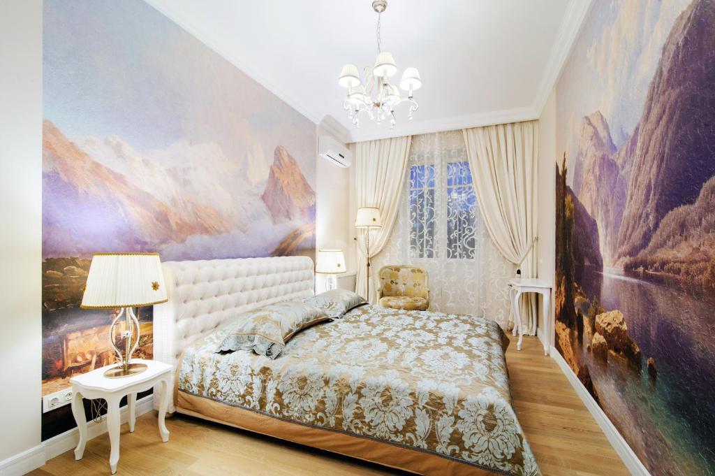 A bed or beds in a room at Vip-kvartira Volodarskogo