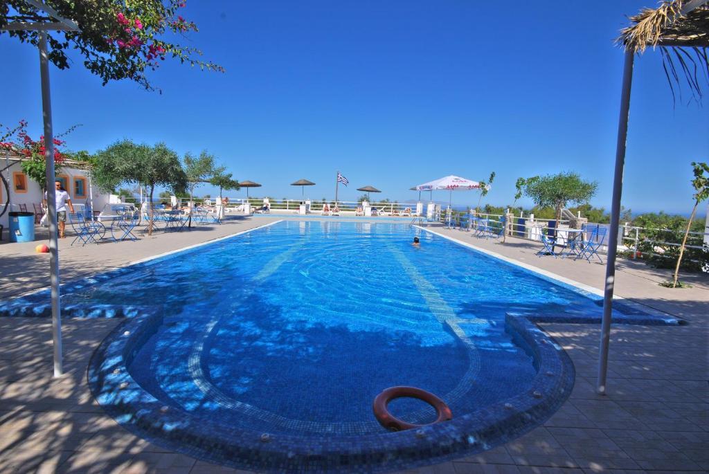 The swimming pool at or near Santorini Hostel