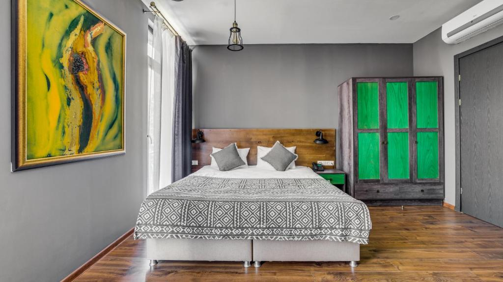 A bed or beds in a room at Hotel Gino Wellness Mtskheta