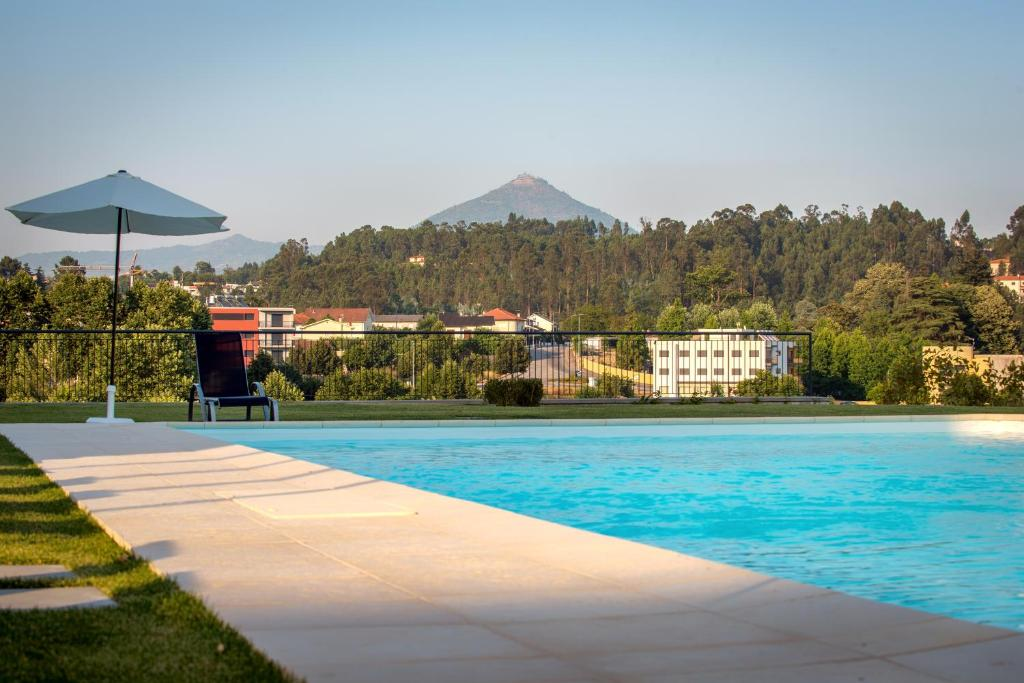 The swimming pool at or near Celorico Palace Hotel & Spa