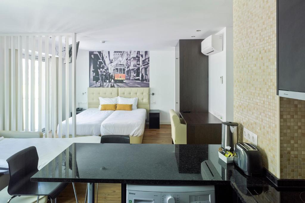 Una habitación en Lisbon City Apartments & Suites