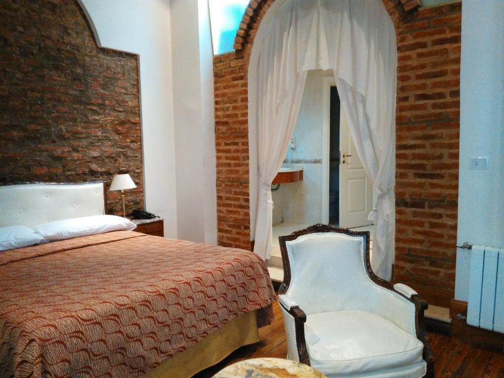 A bed or beds in a room at Hotel A&B Internacional