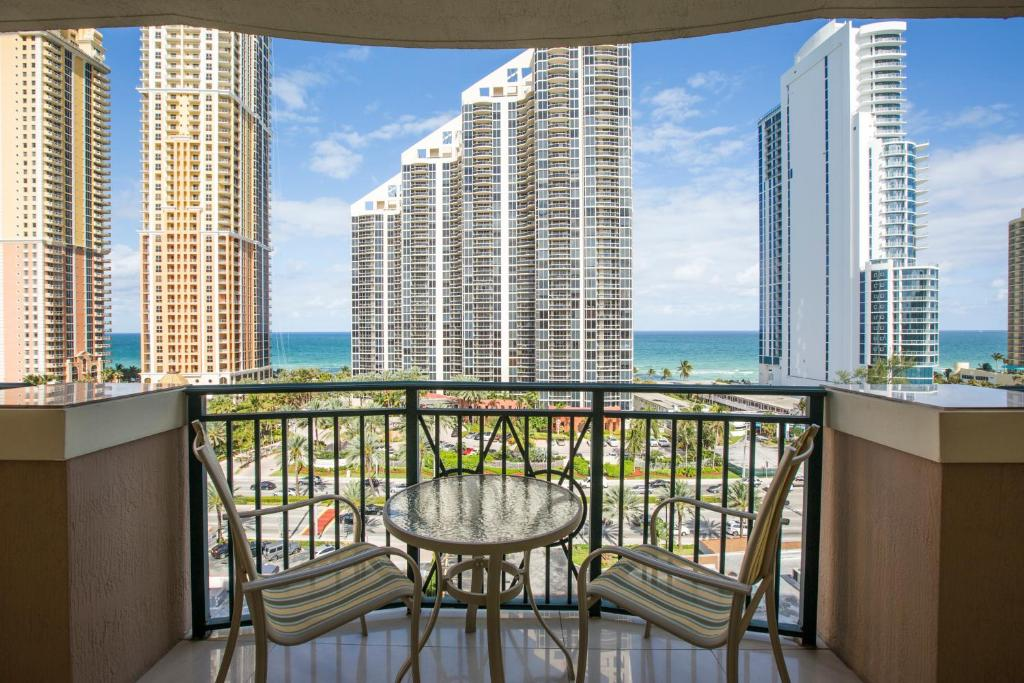 A balcony or terrace at Apartment By Great Sunny Isles Lodging