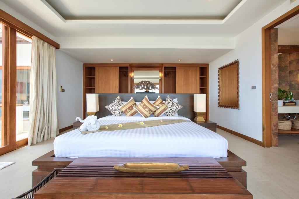 A bed or beds in a room at Ban Lealay