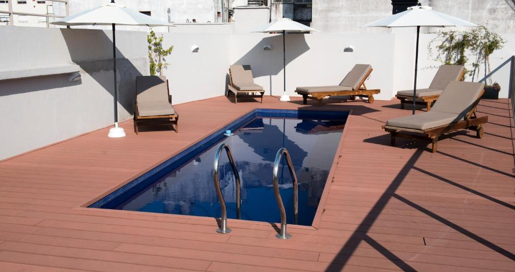 The swimming pool at or close to ARC Arenales Studios & Suites