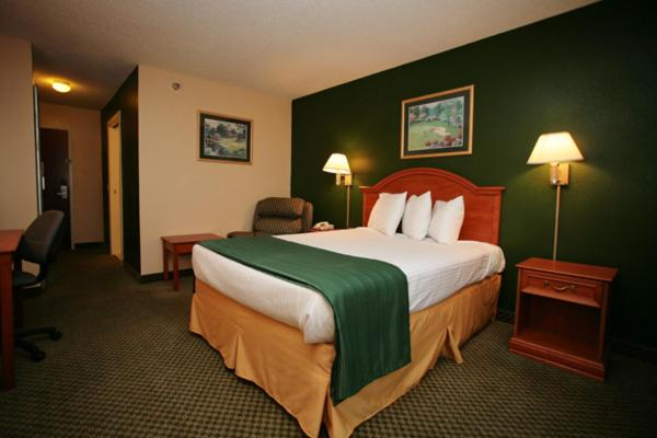 A bed or beds in a room at Americas Best Value Inn Louisville