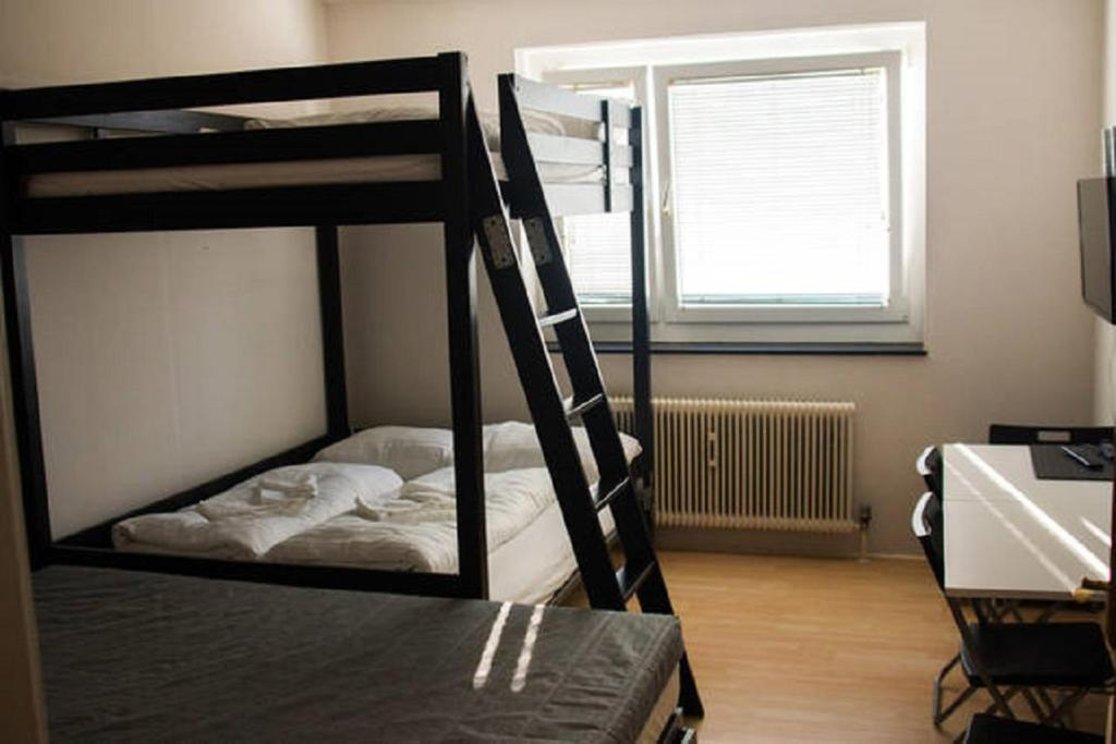 A bunk bed or bunk beds in a room at Apartment F