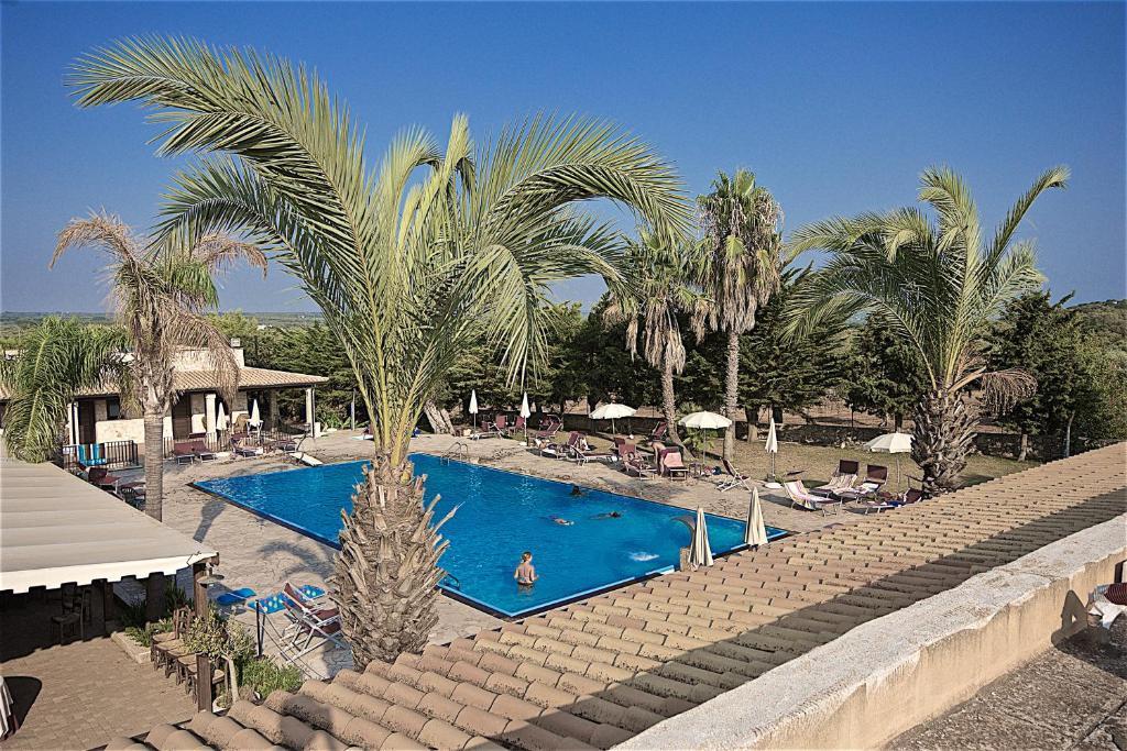 The swimming pool at or near Hotel Masseria Le Pajare